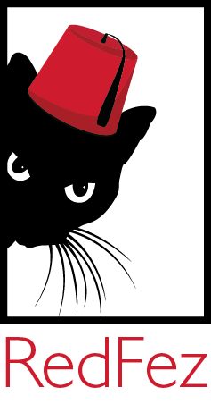 Black cat wearing a red fez